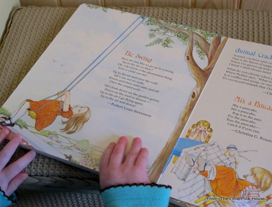 """little hands reading """"The Swing"""" in the board book"""