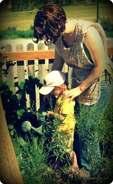watering her carrot