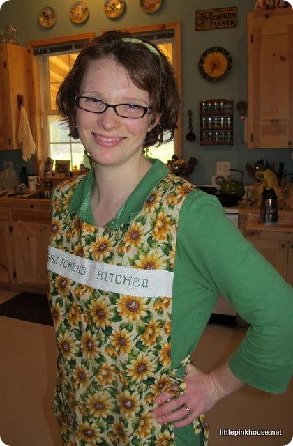in my sunflower kitchen wearing my sunflower apron