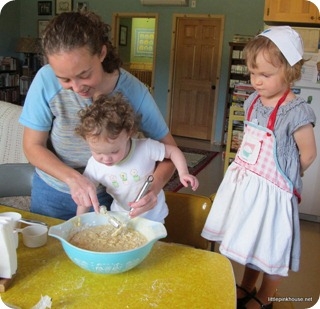 "Mary is helping cousin Jennifer make blueberry muffins while ""Nurse Nancy"" stands by watching"