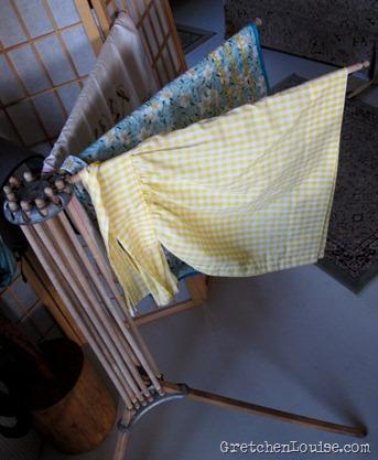 aprons on my umbrella-style laundry rack