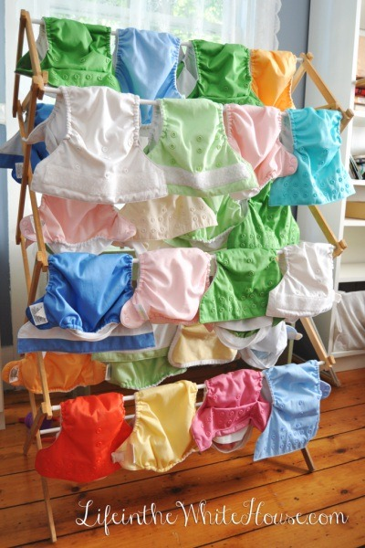 cloth diapers on a drying rack